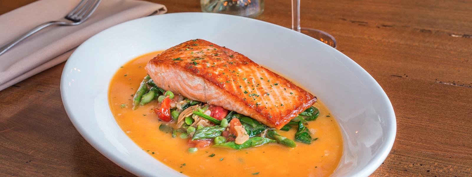 Salmon on dish with garnish